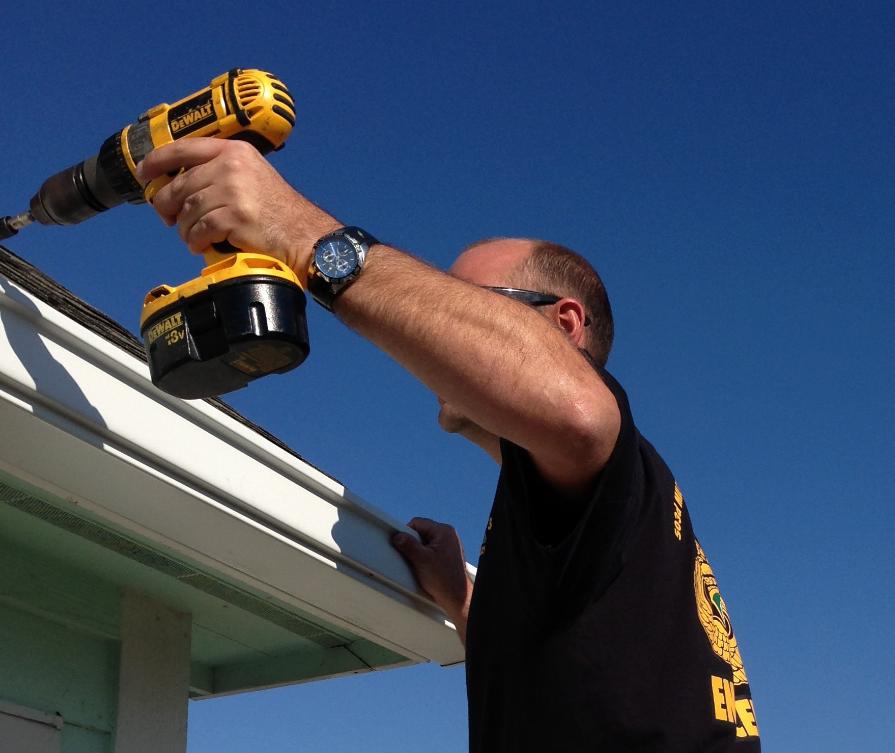 man doing roof repair